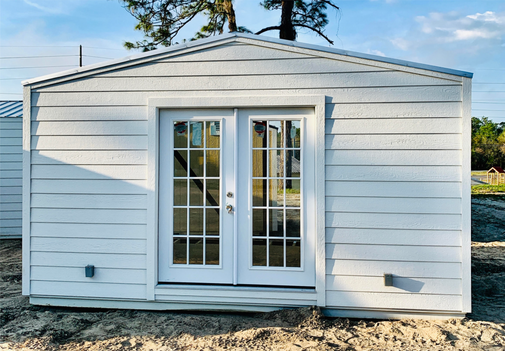 Probuilt Structures Sleel Building Storage Building Sheds She Sheds Man Cave Car port Boat Port RV Port White shed with double doors