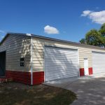 30x50 Steel Building, with wainscot siding Red and cream With two white garage doors Probuilt structures robin sheds Steel buildings for sale in central florida citrus county and marion county Installation pictures