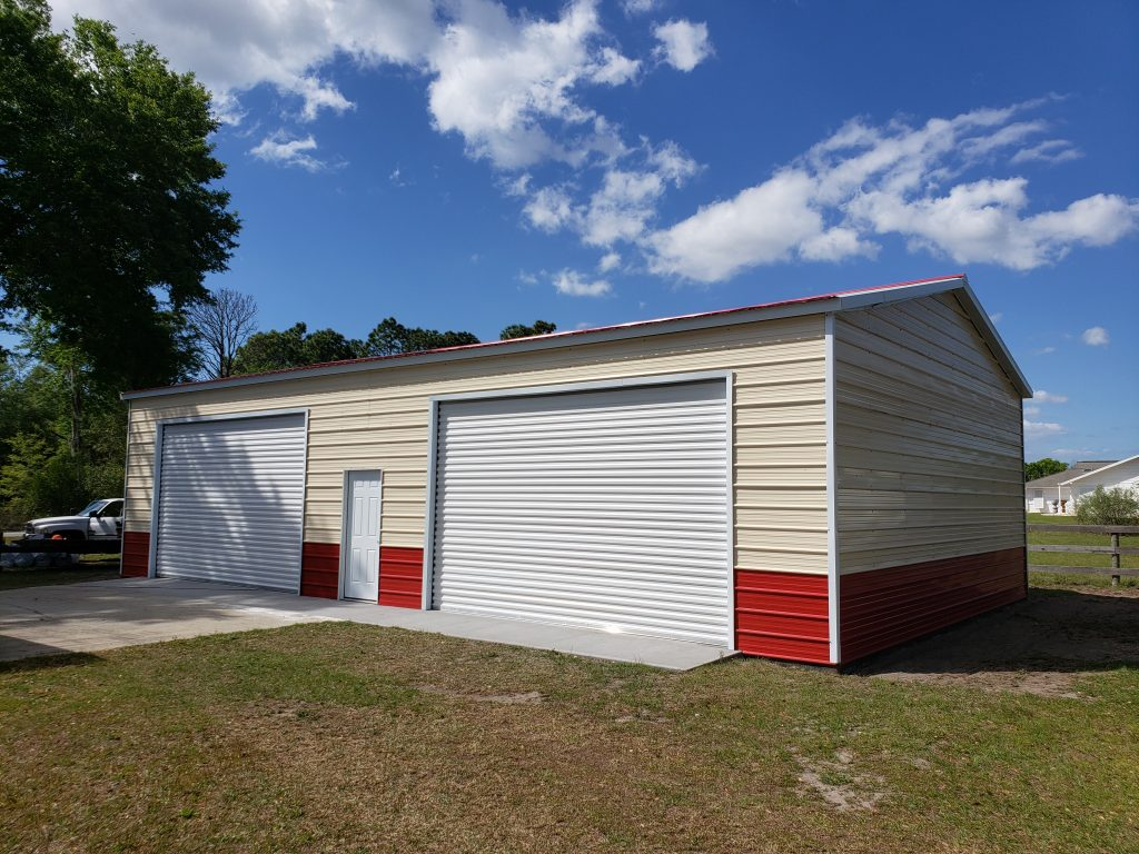 30x50 Steel Building, with wainscot siding Red and cream With two white garage doors Probuilt structures robin sheds Steel buildings for sale in central florida citrus county and marion county Finished pictures of double garage doors exterior