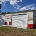 30x50 Steel Building, with wainscot siding Red and cream With two white garage doors Probuilt structures robin sheds Steel buildings for sale in central florida citrus county and marion county Finished exterior pictures with double garage doors and walk door