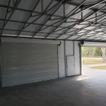 30x50 Steel Building, with wainscot siding Red and cream With two white garage doors Probuilt structures robin sheds Steel buildings for sale in central florida citrus county and marion county Two garage doors finished interior pictures