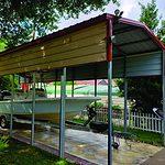 Probuilt Structures Sleel Building Storage Building Sheds She Sheds Man Cave Car port Boat Port RV Port red and tan